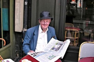 Richard Guston at his standard café and restaurant, Le Commerce, being interviewed after he has just turned 90