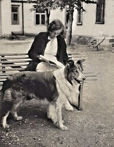 Mother reading the newspaper and Pojken (the Boy), our wonderful collie dog – in the courtyard of the building where Mother had her photography store, studio and work rooms.
