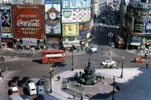 Piccadilly Circus with the Eros statue in the foreground. Photo probably from the late sixties. In '72 the Guinness Time huge clock was gone.