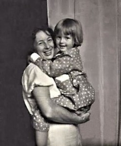 Siv, 4 years old in Vaggeryd, in new pajamas, light blue with white dots. Pappa took the picture. Mother had forgotten to close the curtain on the back of her atelier.