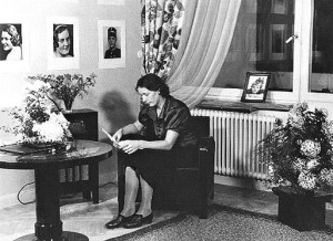 Mother's fancy studio is inaugurated at Gustav Adolfs torg 8b. Mother is posing in her waiting room. The radio is one we took over when she left this studio. It was a great improvement over the square box we had on Kristinelundsvägen.