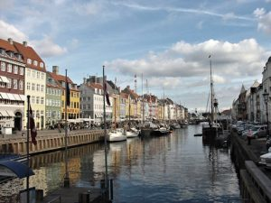 A spruced-up Nyhavn, where tourists gather to try to catch a glimpse of old sinful Copenhagen, but it doesn't look the way it used to any more.