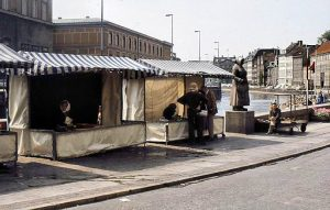 Two of the last remaining fish selling stands at the end of Gammel Strand. John is sitting next to the statue called 'the last fish wife',
