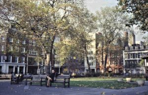 In 1983 on one of our visits in London we walked around the center and had a first look for me at least at Soho. Here is John sitting on a park bench in Soho Square.