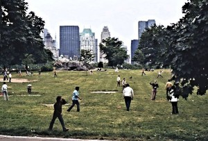 Young people playing football in one of the innumerable fields in the Park. Central Park West in the background