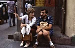 Ted and Siv waiting for Bella and Roy for dinner in Chinatown. Ted has the beer cans in a brown bag on his lap.